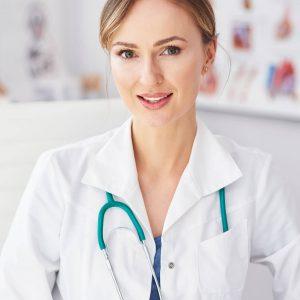 portrait-of-smiling-female-doctor-in-her-doctors-o-UD6NDB6.jpg